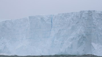 an iceburg in the sea