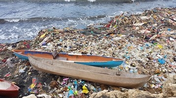 2 boats on litter on a beach